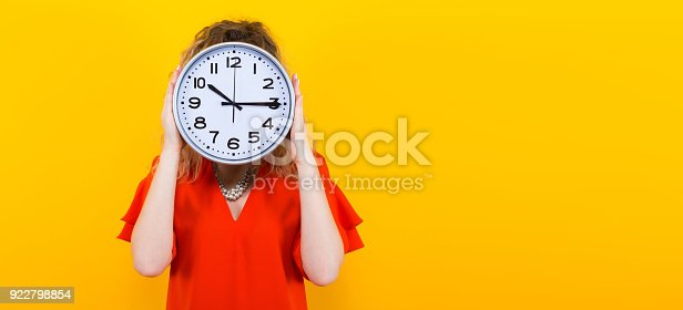 816405814 istock photo Woman in dress with clocks 922798854