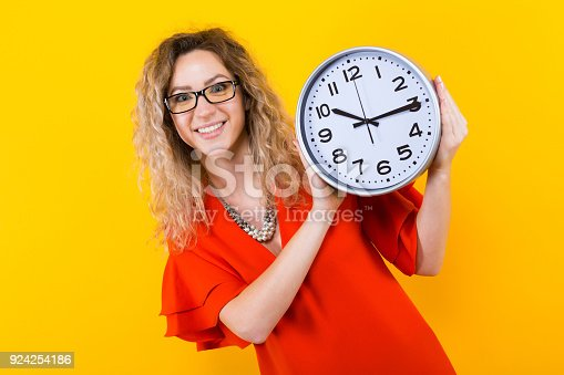 816405814 istock photo Woman in dress with clocks 924254186