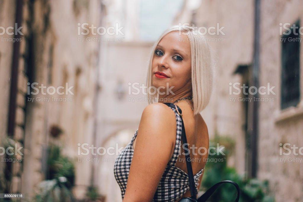 Woman in Dubrovnik street stock photo