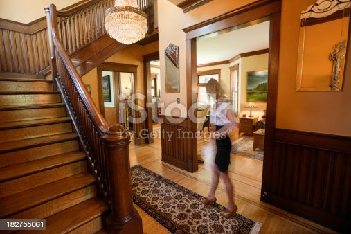 Victorian Home Foyer : Woman in entryway foyer of renovated restored victorian
