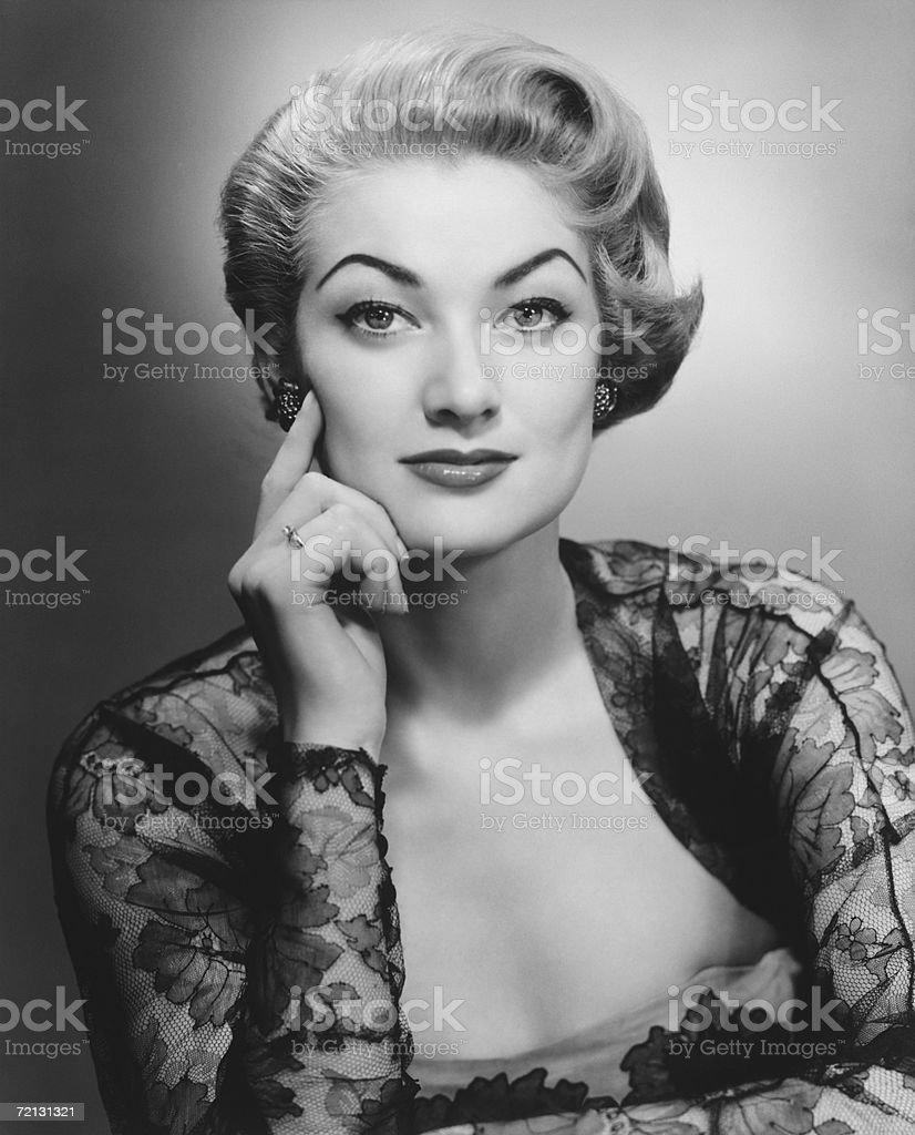 Woman in evening dress posing in studio (B&W), portrait stock photo