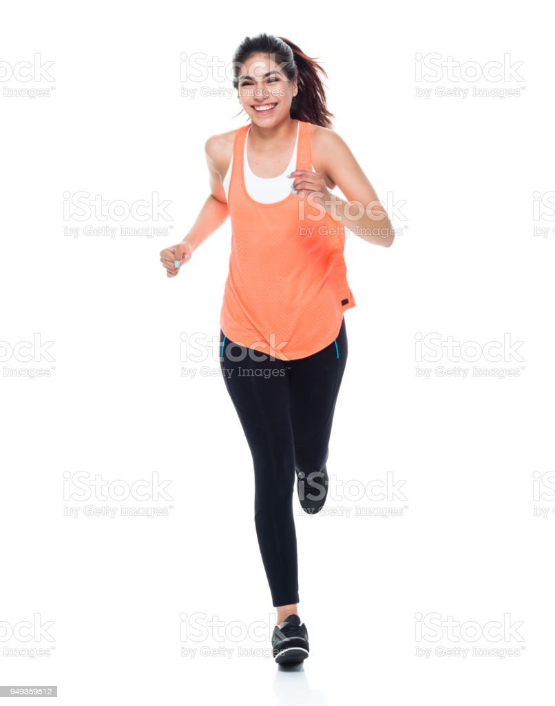 Woman in exercise clothes running stock photo