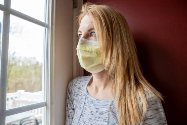 Woman in Face Mask About to Go Outdoors stock photo