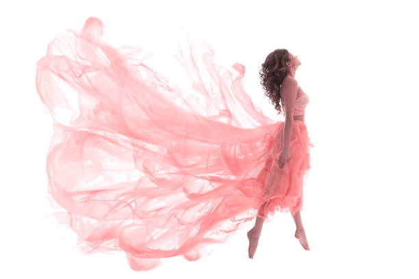 Woman in Fashion Pink Dress, Ballet Dancer Girl in Jump Flying in Dance Woman in Fashion Pink Dress, Ballet Dancer Girl in Jump Flying in Dance over White Background floating fabric stock pictures, royalty-free photos & images