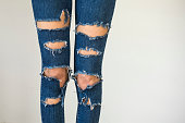 Woman in fashionable ripped Jeans