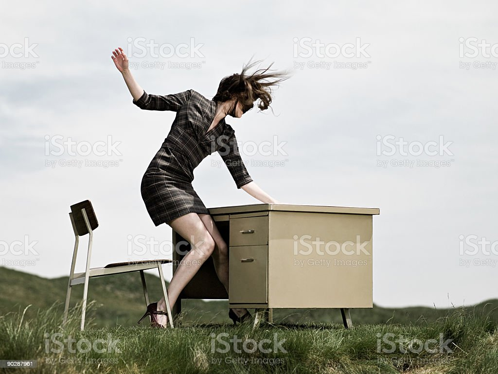 Woman in field with desk royalty-free stock photo