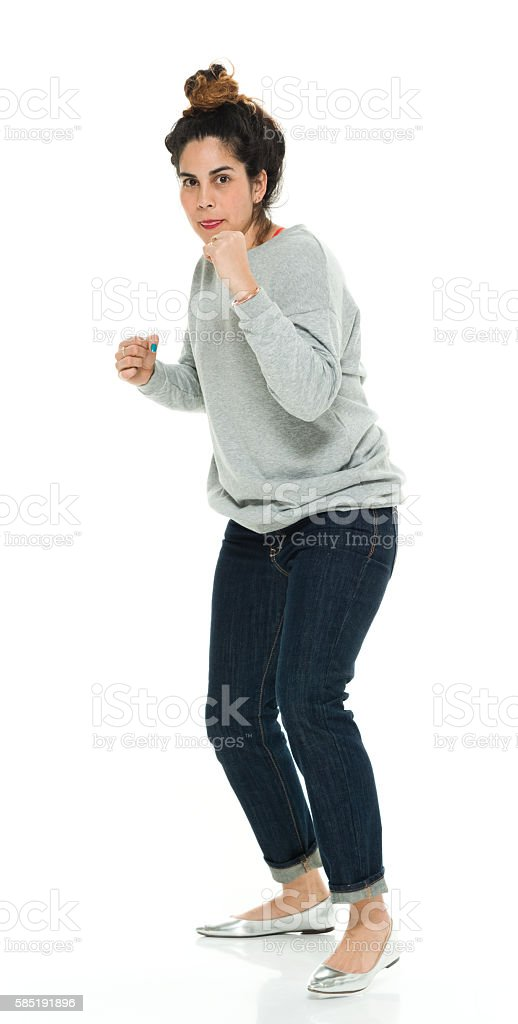 Woman in fighting stance stock photo