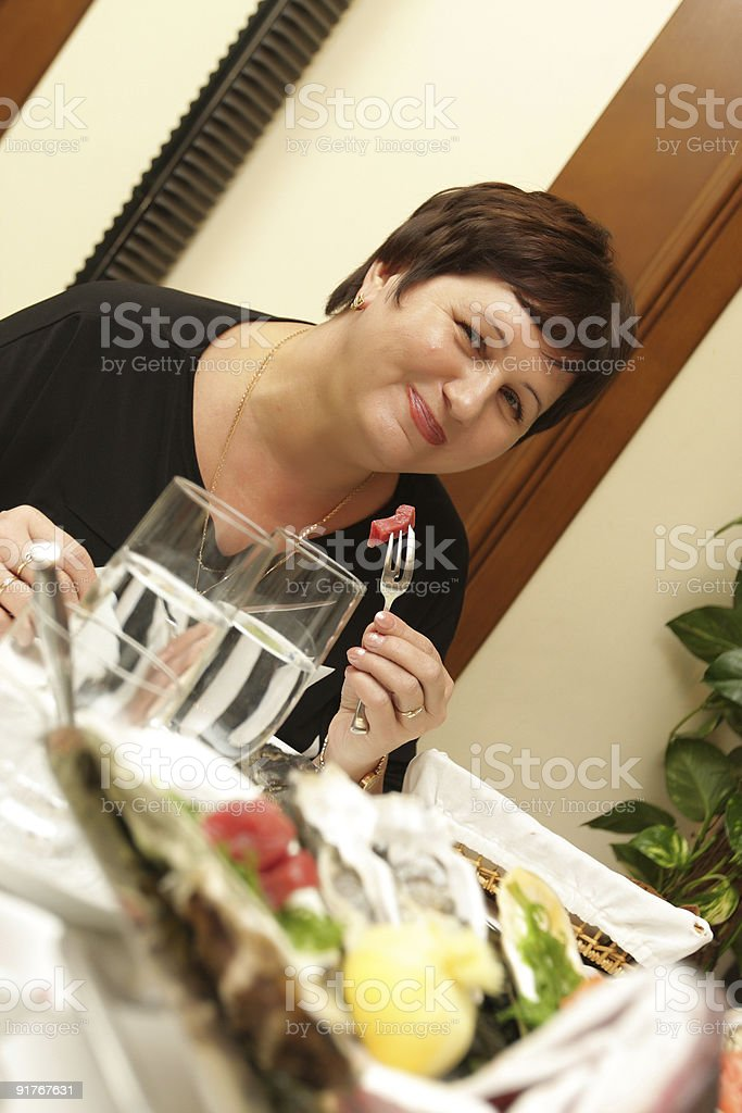 Woman in fish restaurant royalty-free stock photo