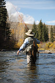 Woman fly-fishing on the Blue River in Colorado.