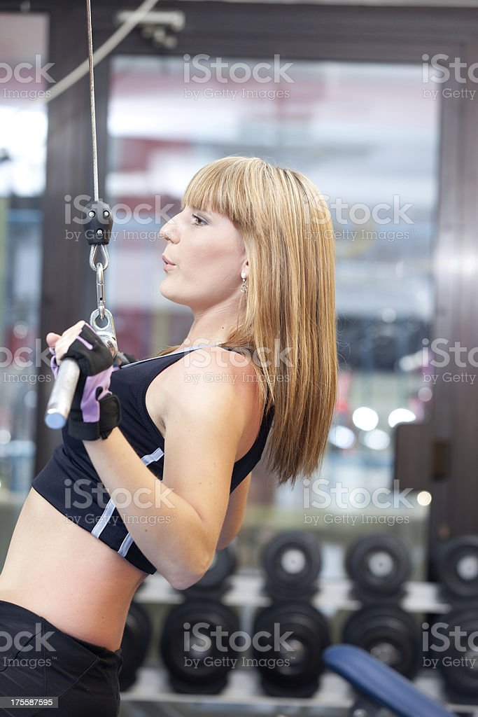 Woman in fitness club stock photo