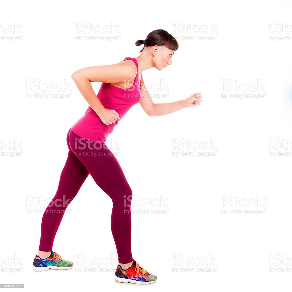 Woman in fitness wear running. Isolated over white background. stock photo