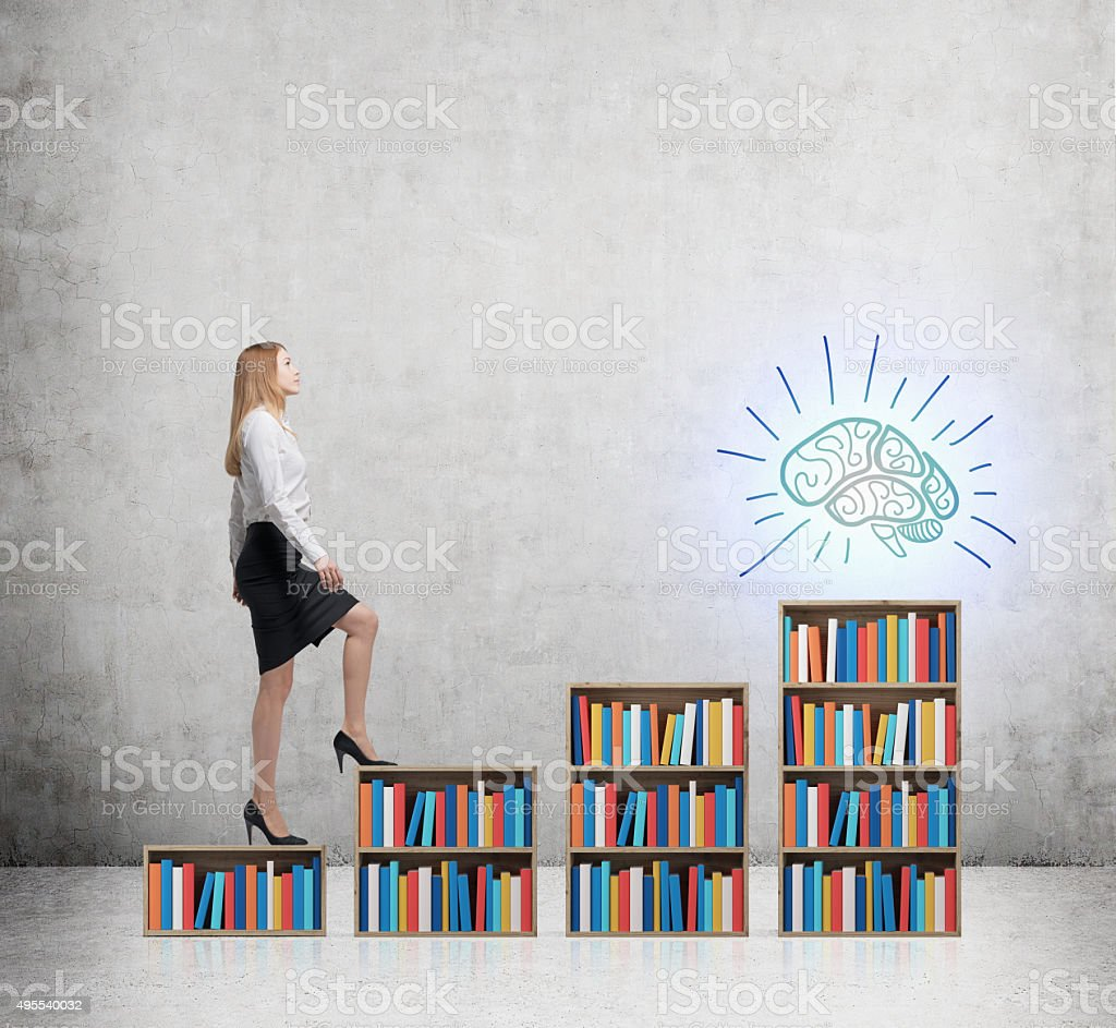 woman in formal clothes is going up on the bookshelf. stock photo