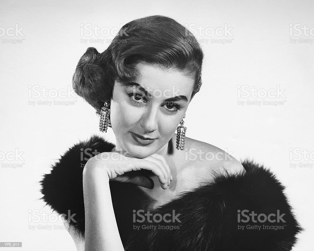 Woman in formal dress with fur stole around shoulders royalty-free stock photo