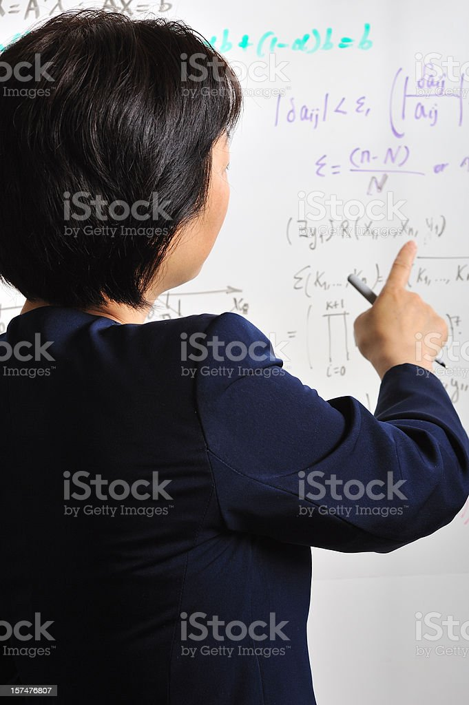 Woman in front of a board with mathematical formulas royalty-free stock photo