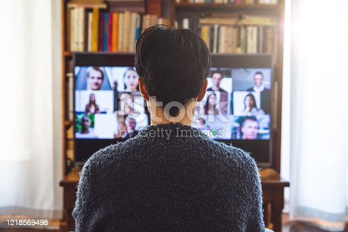 istock Woman in front of a device screen in video conference for work 1218569498