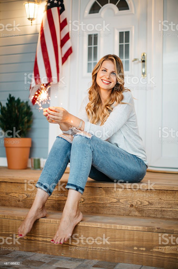 Woman in front of a house. stock photo