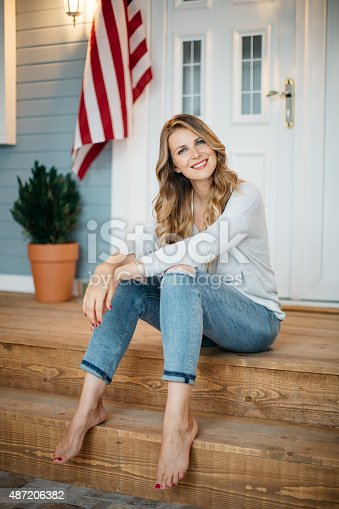 istock Woman in front of a house. 487206382
