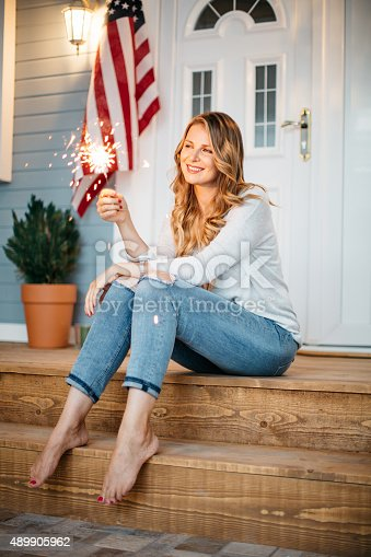 istock Woman in front of a house. 489905962