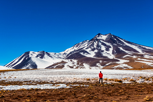 Middle aged woman in front of a snowy mountain