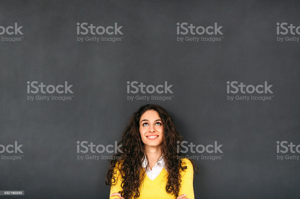 Woman In Front of Blackboard​​​ foto