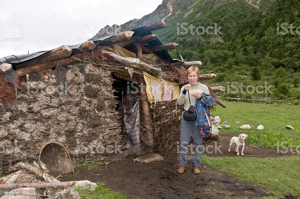 Woman in Front of Cottage Sichuan China royalty-free stock photo