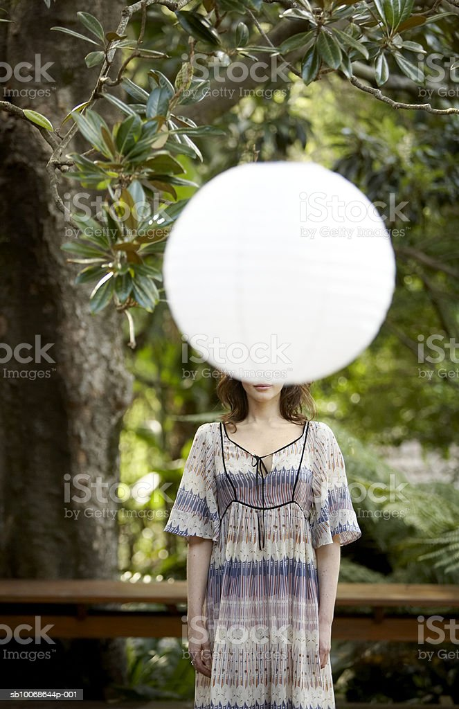 Woman in front of electric lamp royalty-free stock photo