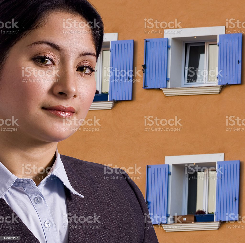 Woman in front of house royalty-free stock photo