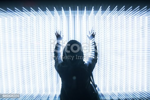 istock woman in front of LED lights dots array 655304224