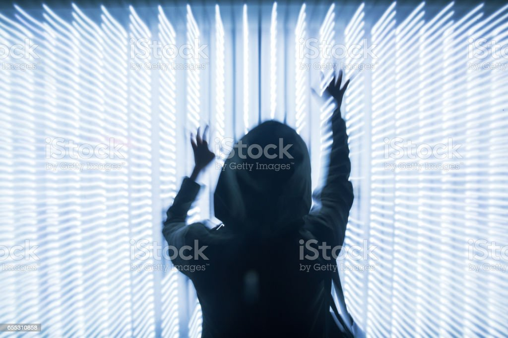 woman in front of LED lights dots array stock photo