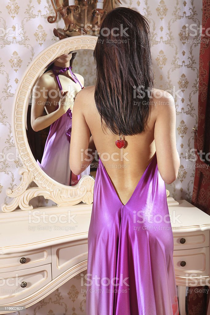 woman in front of mirror royalty-free stock photo