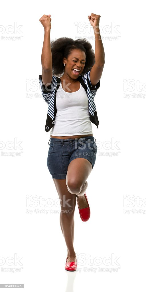 Woman in front of white background with her arms in the air stock photo