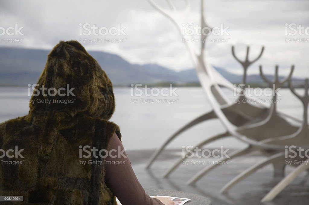 Woman in fur on Island stock photo