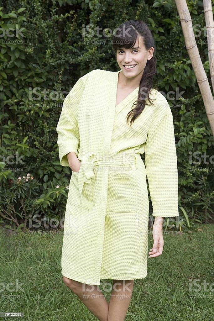 Woman in garden in bathrobe 免版稅 stock photo