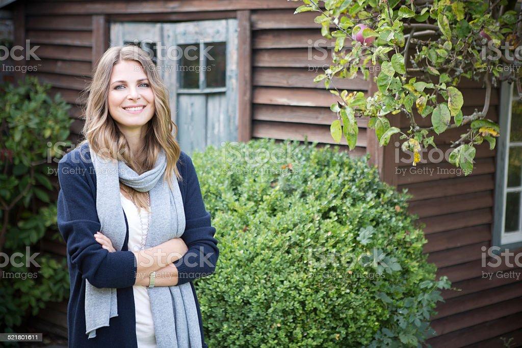 Woman in garden. stock photo