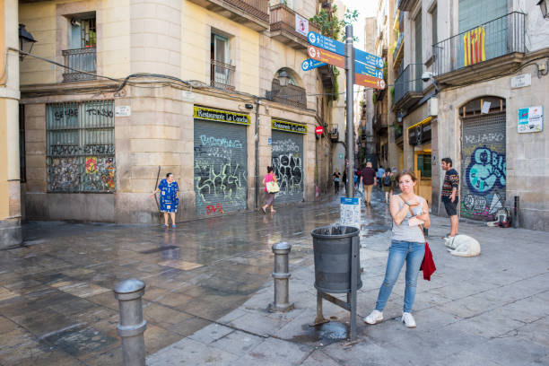 Woman In George Orwell Plaza In Barcelona Stock Photo Download