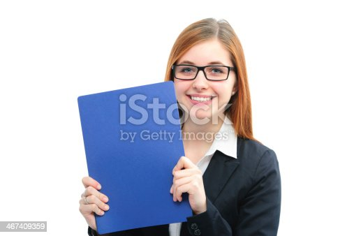 istock Woman in glasses and business suit holding a blue folder 467409359