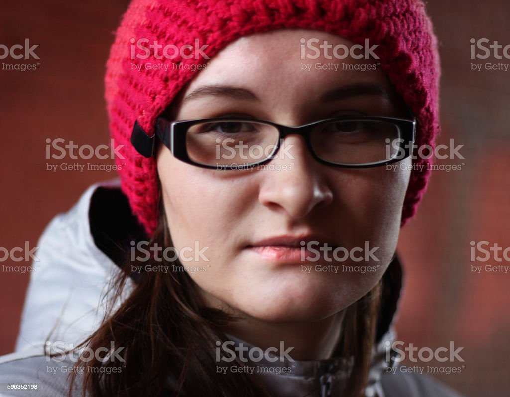 Woman in glasses and pink cap royalty-free stock photo