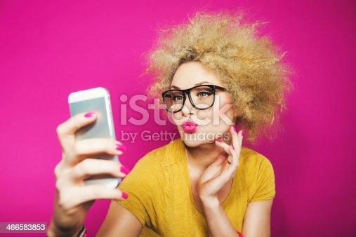 istock Woman in glasses taking a selfie 466583853