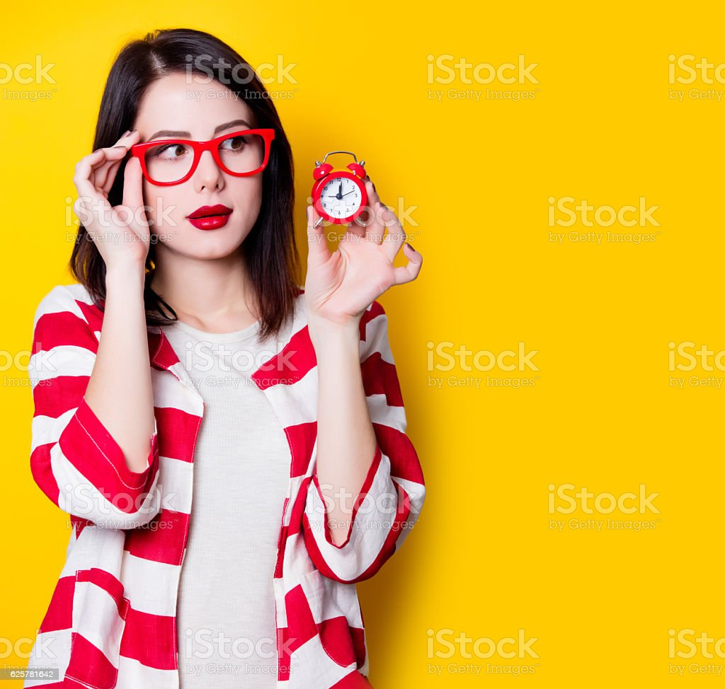 woman in glasses with retro alarm clock - foto de acervo