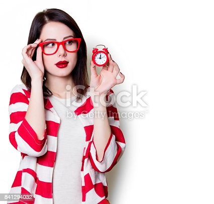 istock woman in glasses with retro alarm clock 841294032