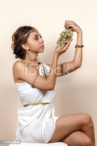 istock woman in greek style clothes on isolated background 1153643832