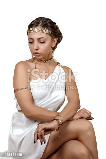 istock woman in greek style clothes on isolated background 1153644149