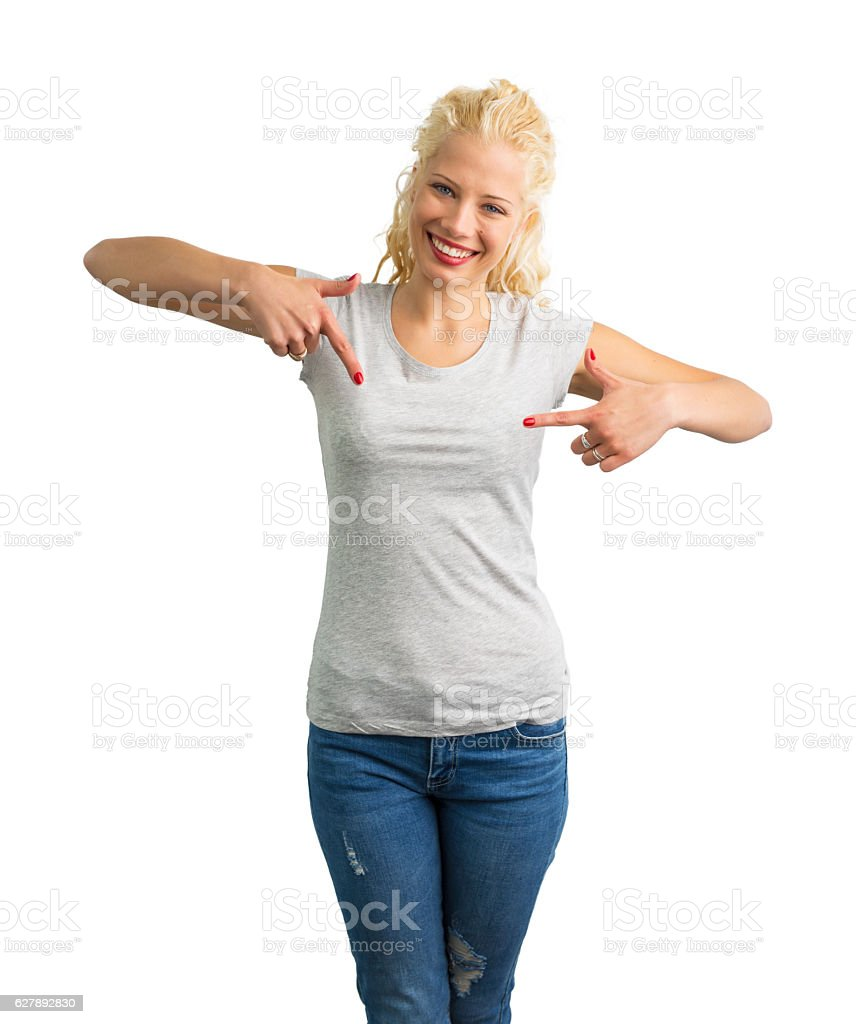 Woman in grey round neck T-shirt pointing at it stock photo