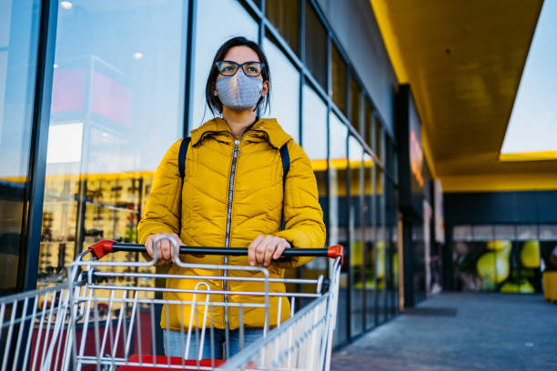 Woman in grocery store with face mask stock photo