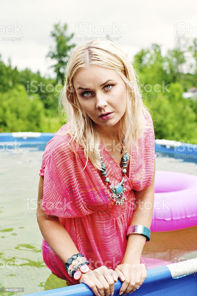 Woman in ground pool stock photo