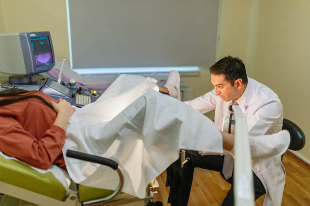 Woman in gynecological chair during gynecological check up with her doctor. Gynecologist examines a woman Woman in gynecological chair during gynecological check up with her doctor. Gynecologist examines a woman pap smear stock pictures, royalty-free photos & images