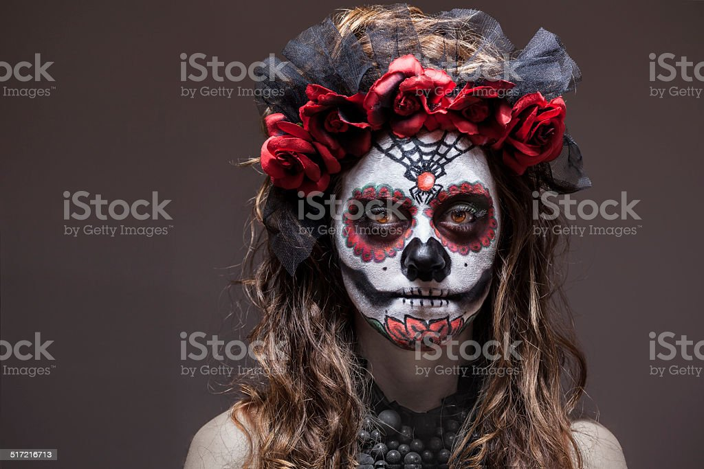 Woman in Halloween costume and skull makeup stock photo