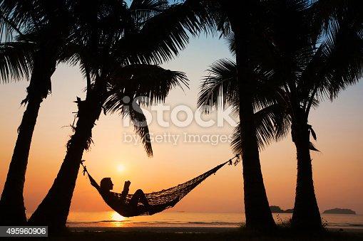 817409212 istock photo woman in hammock on the beach 495960906