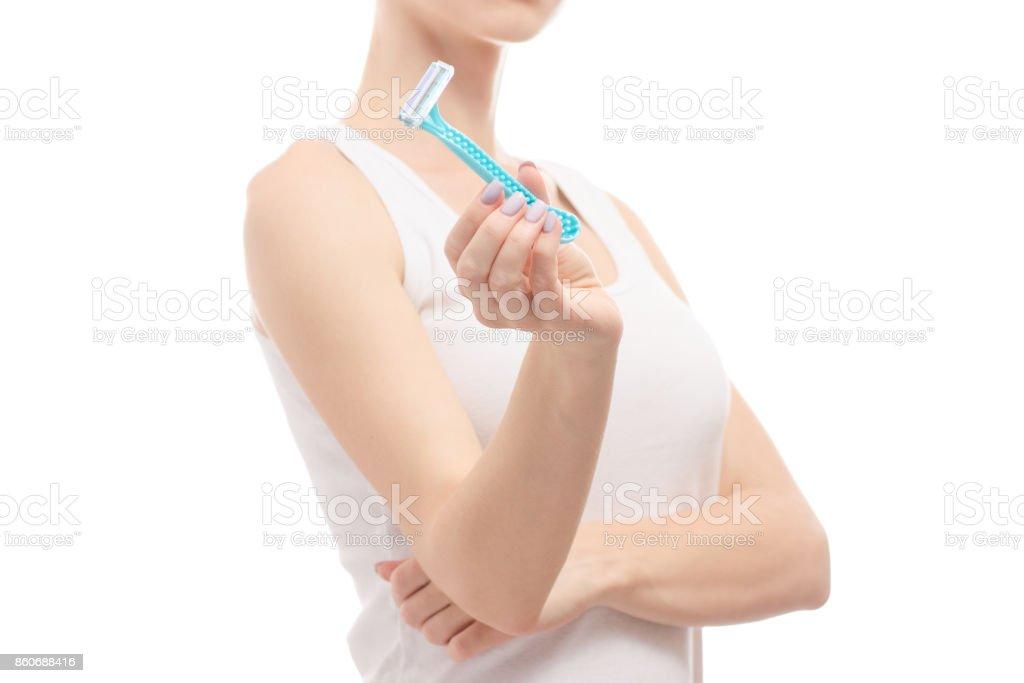 Woman in hand razors shaving stock photo