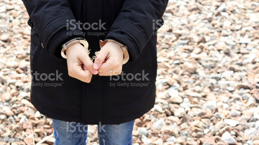 A woman in handcuffs. stock photo